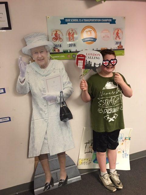 Boy posing w Queen Elizabeth cutout