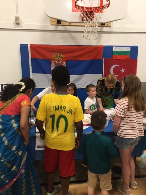 People visiting an international table