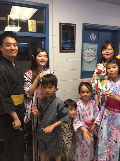 Group of adults and children in international dress