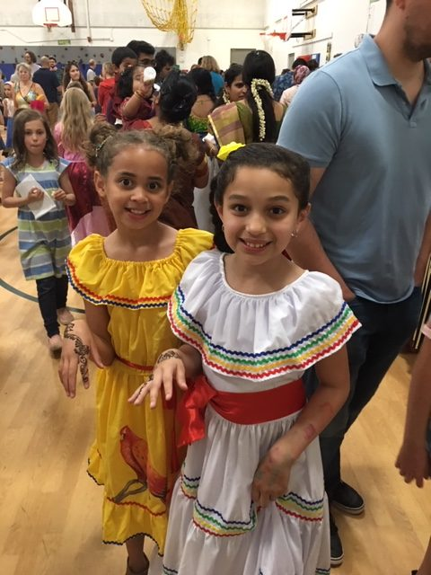 Two girls in International dresses