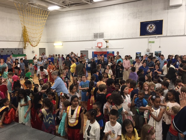 Group shot of families at the International Night performance