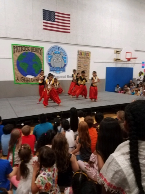 Students performing on a stage