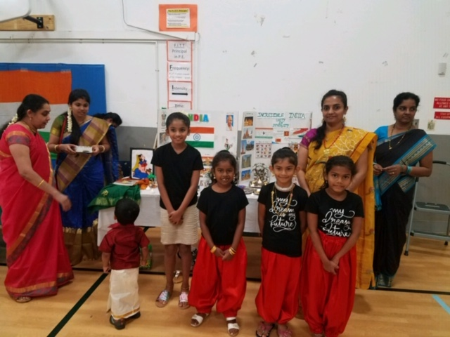 children and adult in traditional dress